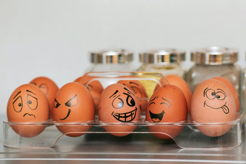 Eggs with emotions drawn on them