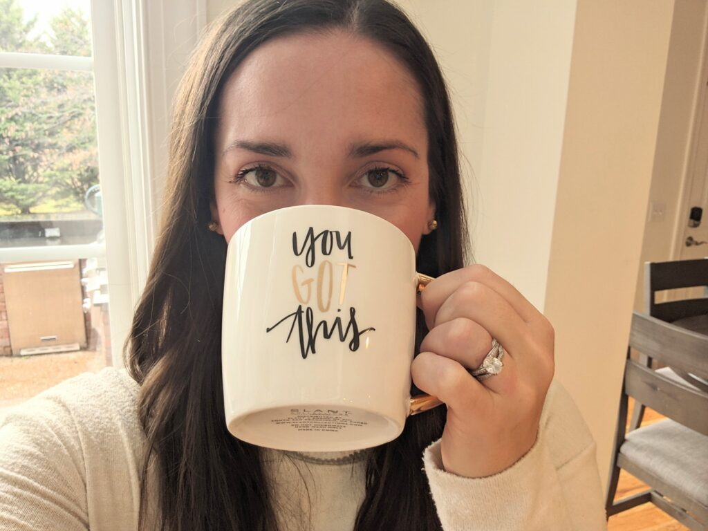 Picture of woman drinking from a coffee my that says you got this