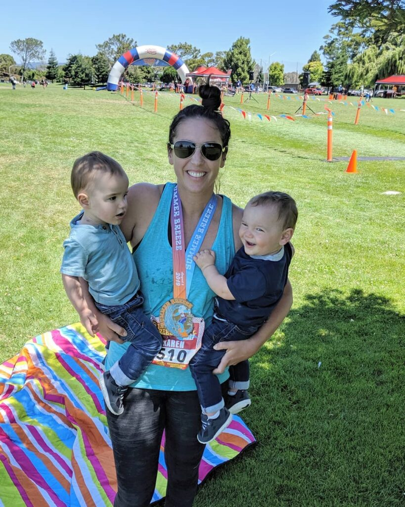 Mom with her twin toddlers after running a half marathon