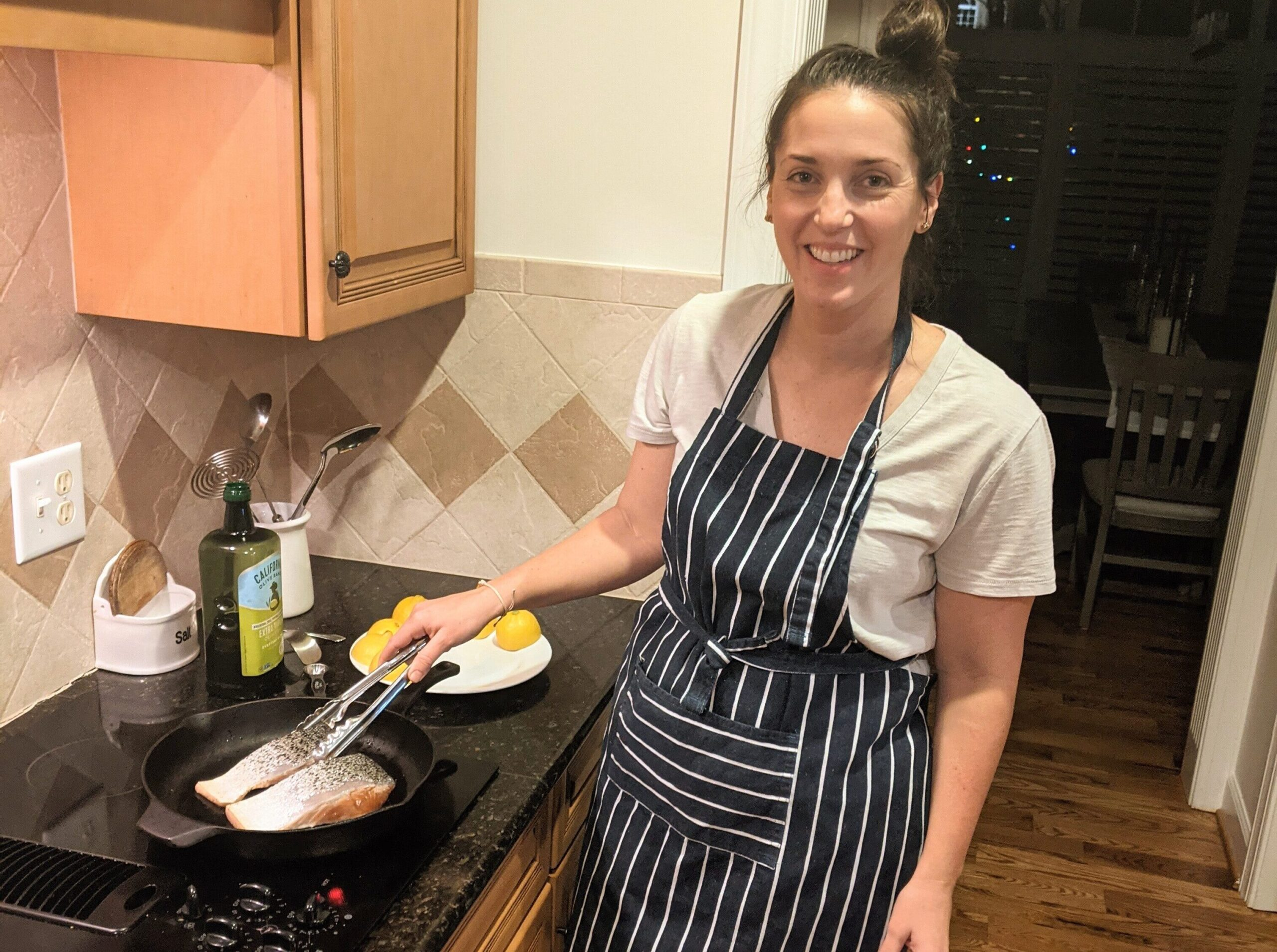 Woman cooking dinner on the stove